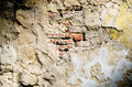 Old red brick in cracked concrete wall background Royalty Free Stock Image