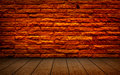 Old red brick Structure of the walls and wood flooring. Royalty Free Stock Photo