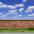 Old red brick wall an with flowers and blue sky Stock Photography