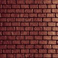 Old red brick wall texture background. Dark brown black block st Royalty Free Stock Photo