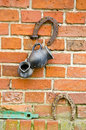 Old red bricks wall with rusted horseshoe and black jug Royalty Free Stock Photo
