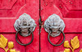 Old red chinese temple door with crave leaf Stock Photos