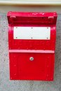 Old red english mailbox
