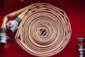 Old red fire hose Royalty Free Stock Photo
