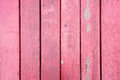 Old, red grunge wood vertical panels on a rustic barn Royalty Free Stock Photo