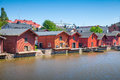 Old red houses on the river coast in porvoo finland june wooden historical finnish town Stock Photography