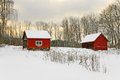 Old red houses in a winter landscape Royalty Free Stock Photo