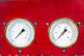 Old red industry panel with two analog meters round measurement Royalty Free Stock Image
