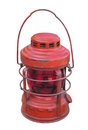 Old red kerosene lantern isolated and worn railroad with glass globe and handle on white Royalty Free Stock Photo