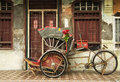 Old red rickshaw and heritage house, Penang, Malaysia Royalty Free Stock Photo