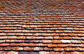 Old red roof tiles with moss Stock Photos