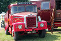 Old red scammell lorry an next to an caravan this vehicle was at the bedfordshire county show in the united kingdom Stock Image