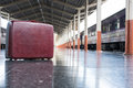 old red suitcase, baggage or luggage on platform at train statio Royalty Free Stock Photo