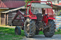 Old red tractor with loader Royalty Free Stock Photo