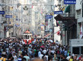 Old red tram on istiklal street istanbul turkey august taksim at eventide august in istanbul turkey taksim is a popular tourist Stock Photo