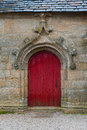 Old red vintage door in church France Stock Photography