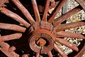 Old red wagon wheel with spokes and hub Royalty Free Stock Photo