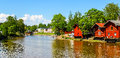 Old red warehouses alongside river porvoo historic city scape of Royalty Free Stock Photos