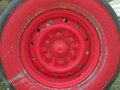 Old red wheel and tire Royalty Free Stock Photo