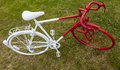 Old red and white bicycle upper view of an painted in grass Royalty Free Stock Photos