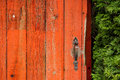 Old, Red, Wooden Door with Vintage Knob or Handle Royalty Free Stock Photo