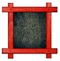 Old red wooden frame against a white background with black wood copy space in the cente Royalty Free Stock Photo