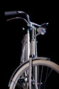 Old refurbished retro bike details isolated on black background detail view of the lever brake handlebars and headlight Stock Image
