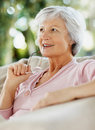 Old relaxed woman deep in thought Stock Photos