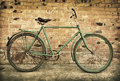 Old retro bicycle against brick wall Royalty Free Stock Photography