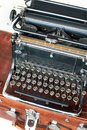 Old retro black metallic typewriter with antique round  keys. Royalty Free Stock Photo