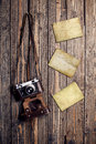 Old retro camera and blank instant photo frames on vintage wooden background Royalty Free Stock Photo