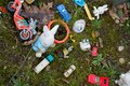 Old retro childrens toys on a childs grave Stock Image