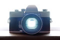 Old retro film camera closeup with backlight through the viewfinder Stock Photography