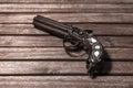 Old, retro gun on wooden background Royalty Free Stock Photo