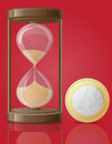 Old retro hourglass and one coin euro vector illus illustration on red background Royalty Free Stock Photos