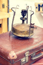 Old retro objects antique gas lamp with a suitcase, vintage image retro style effect. Royalty Free Stock Photo