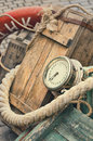 Old retro objects antique textural background wooden crates, chronometer and ropes Royalty Free Stock Photo