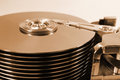 Old retro open hard disk drive. Thick stack of ten platters and Royalty Free Stock Photo