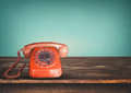 Old retro red telephone on table Royalty Free Stock Photo