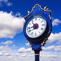 Old retro street clock on a sky background Stock Image