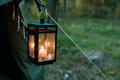 Old Retro Vintage Lantern With Burning Candle Hanging On Camp Tent Royalty Free Stock Photo