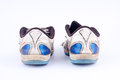 Old retro worn out futsal sports shoes on white background back view Royalty Free Stock Photo