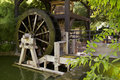 Old river mill water wheel wooden powered by a lazy Stock Photos