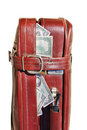 Old road bag  full of money Royalty Free Stock Photo
