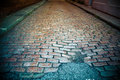 Old road cobblestone street in disrepair Stock Photos