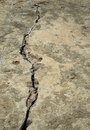 Old road in disrepair an neglected and with a large crack developing Royalty Free Stock Images