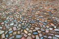 The old roadway of granite cobblestone. Wet road Royalty Free Stock Photo
