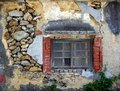 Old rock wall with window an house walls made from rocks wood frame Stock Image