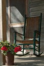 Old Rocking Chair on Cracker House Porch Royalty Free Stock Photo