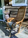 A rocking chair on the front porch of the cabin Royalty Free Stock Photo